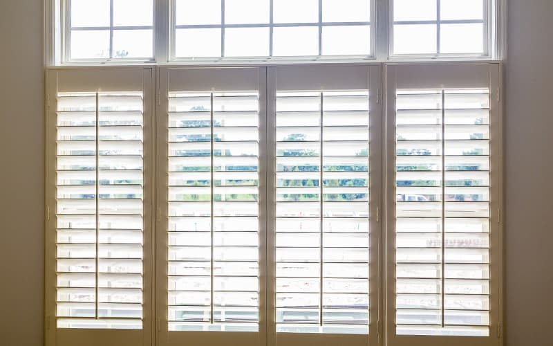 faux wood shutters or blinds